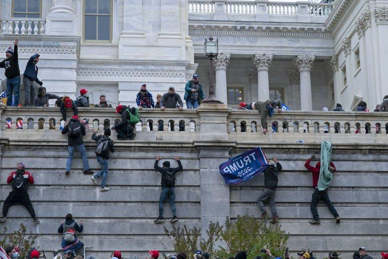 Capitol Rioters Climb Wall