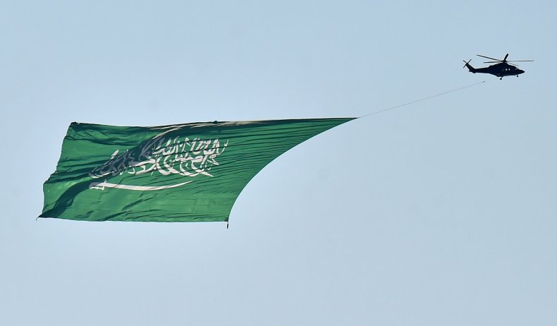Saudi military helicopter, carrying a huge flag
