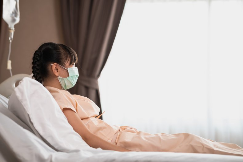 A girl wearing a facemask in hospital