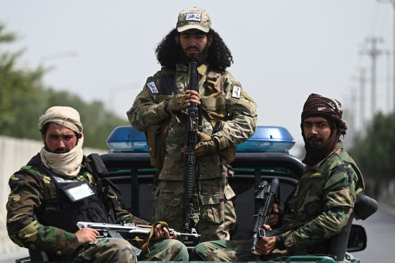 Taliban fighters guard a rally in Kabul