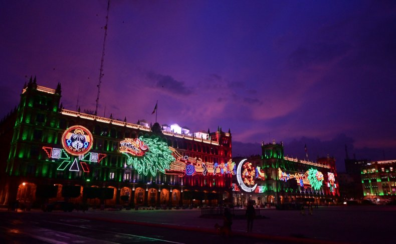 A building illuminated for Mexican Independence Day.