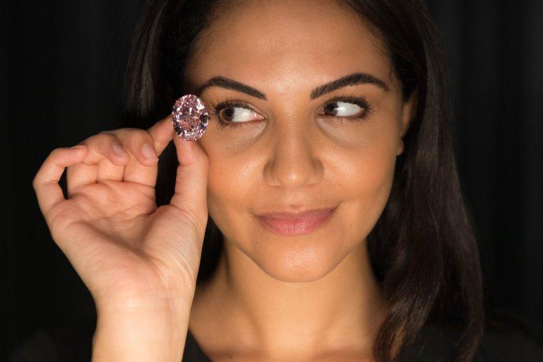 "A model displays the ""Pink Star"" diamond."