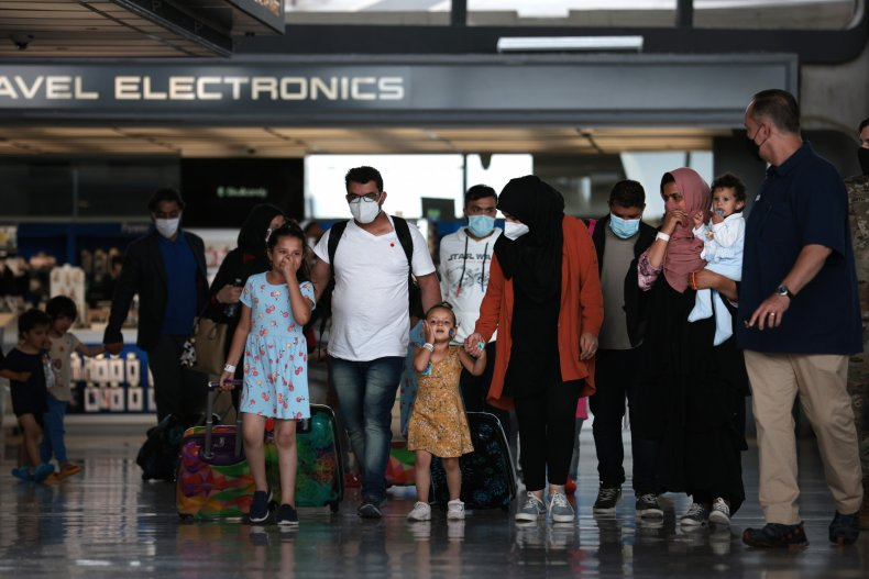 Afghan Refugees Arrive At Dulles Airport After US Pulls Out Final Troop