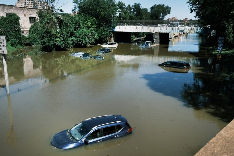 Xars sit abandoned on the flooded highway
