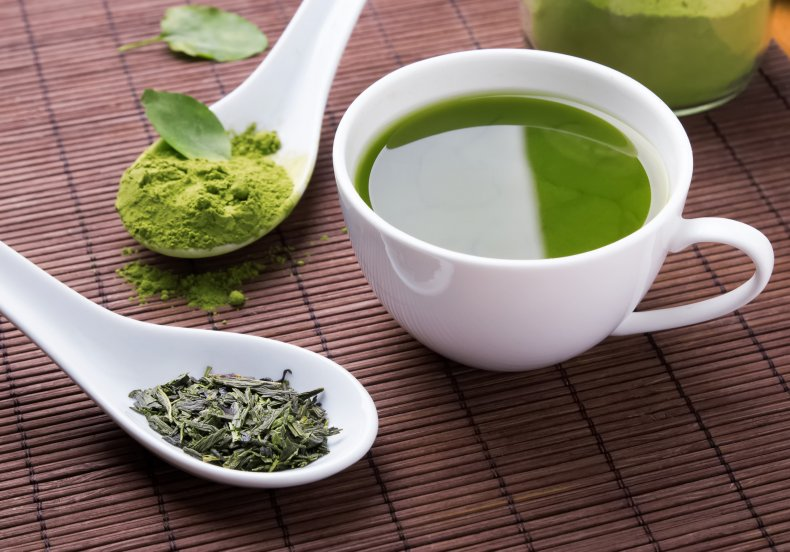 A cup of green tea and powder.