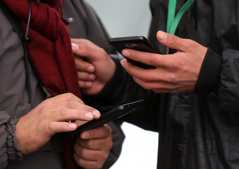 People hold smartphones in their hands