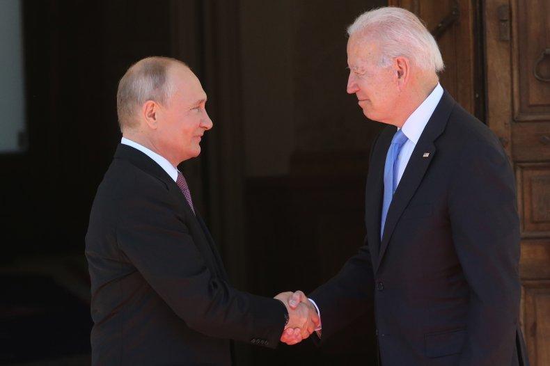Vladimir Putin greets Joe Biden
