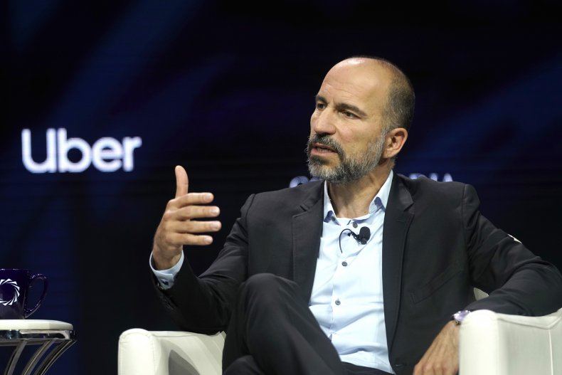 Uber CEO Dara Khosrowshahi speaking on stage.