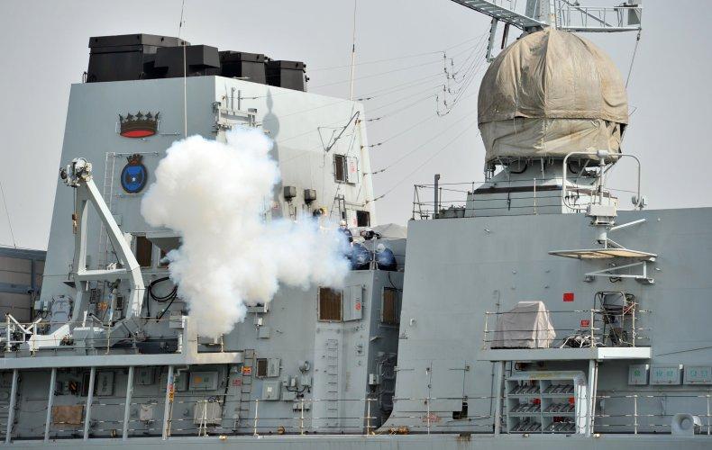 HMS Richmond fires cannon