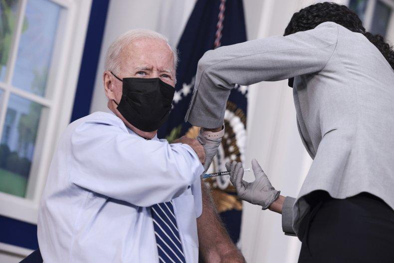 Biden defends booster shots