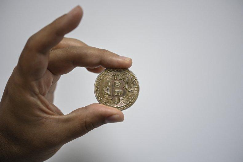 A man shows a souvenir bitcoin