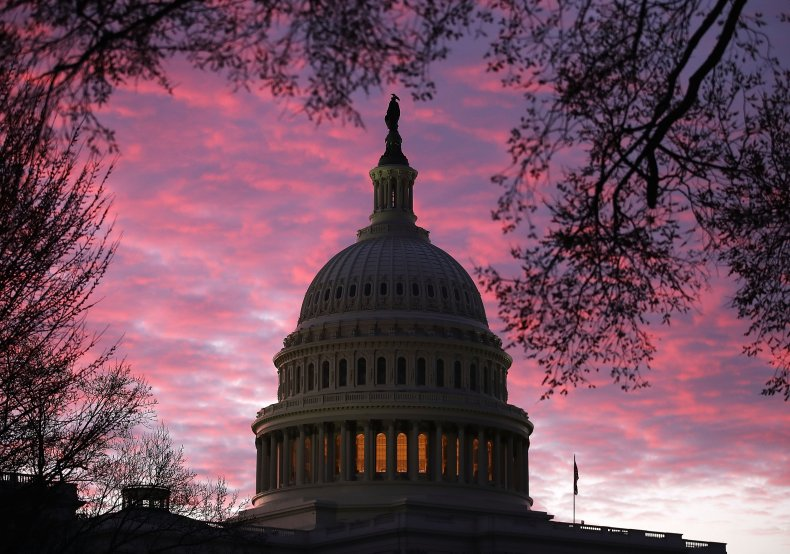 Sun rises behind the U.S. Capitol