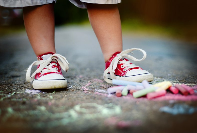 Toddler standing in front of chalk