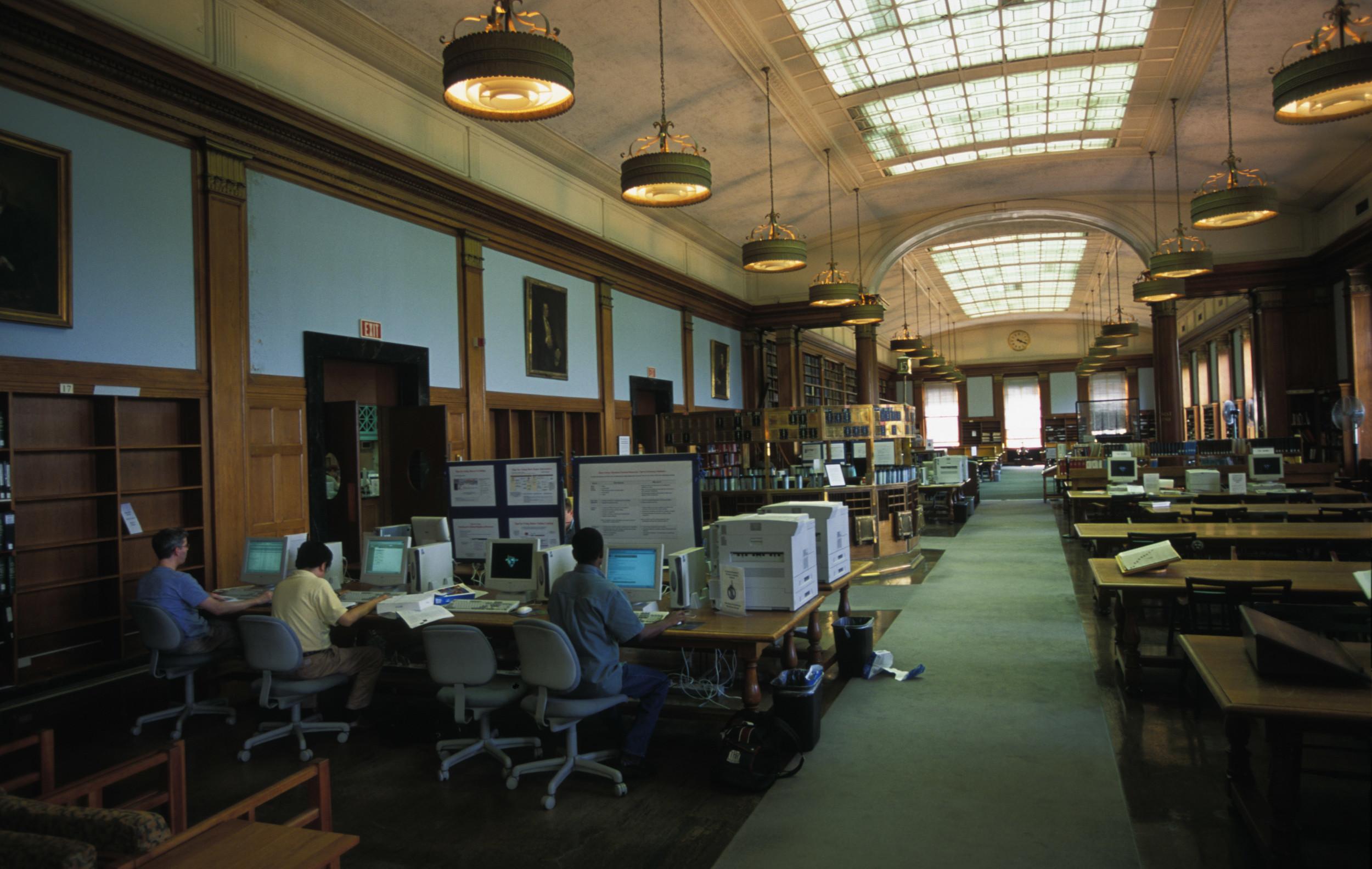 Students work inside Baker Library at Harvard