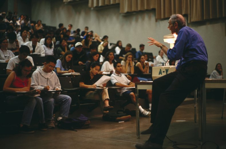 Professor Lecturing Students in Large Hall