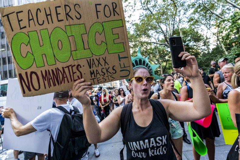 Teachers protest the COVID-19 vaccine mandate