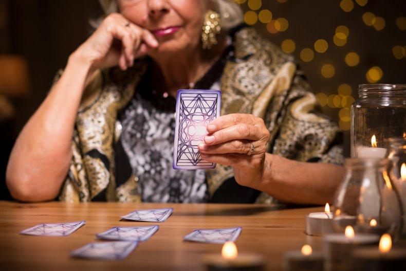 A psychic doing a Tarot card reading.