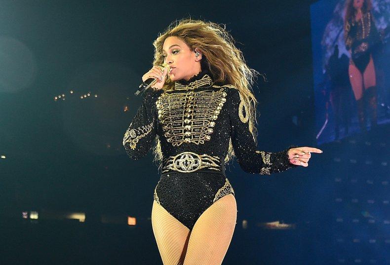 Beyoncé performing on stage.