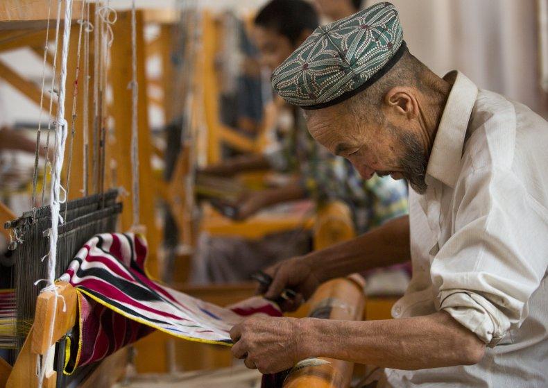 Uyghur worker in a silk factory, Hotan,