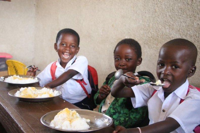 Children enjoying WFP school meals