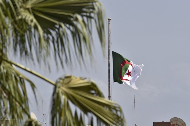 The Algerian national flag flies at half