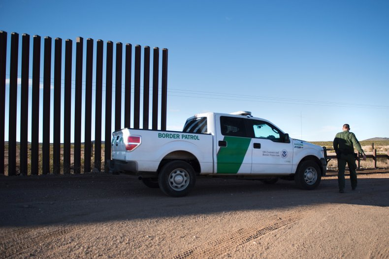 Border Patrol Agent at Wall