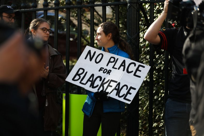 A Protester Holds a Sign Against Blackface