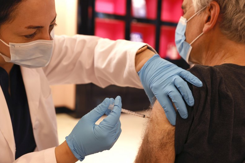 A Pharmacist Administers a COVID Booster Shot