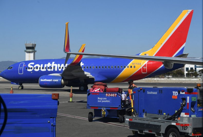 A Southwest Airlines baggage handler loads luggage