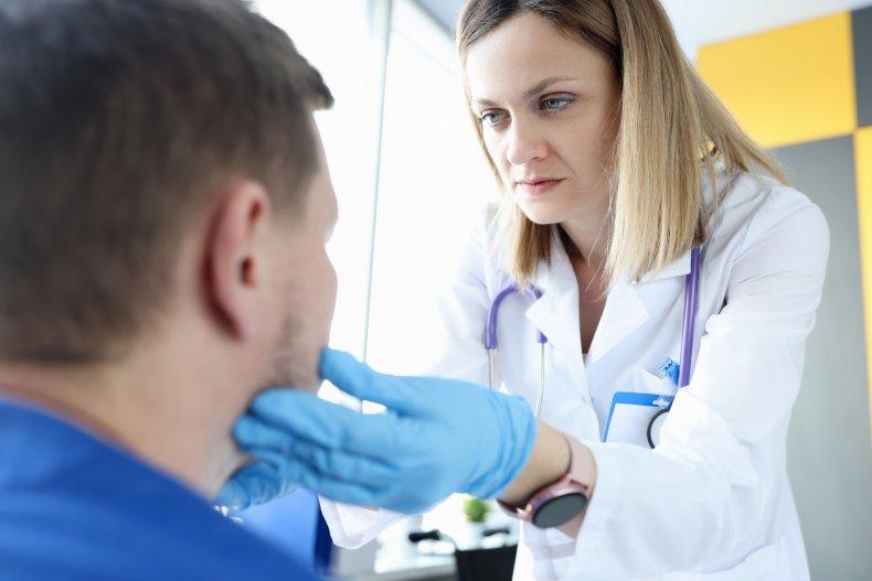 Doctor examines patient's lymph nodes