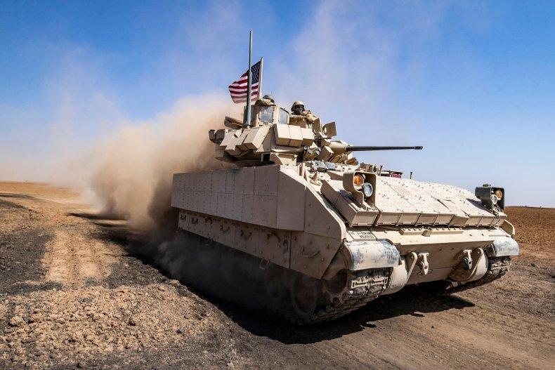 U.S. soldiers patrol Syrian village