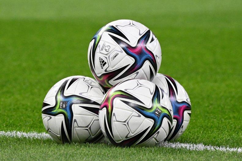 Soccer Balls on Pitch