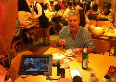 Anthony Bourdain shooting with film crew