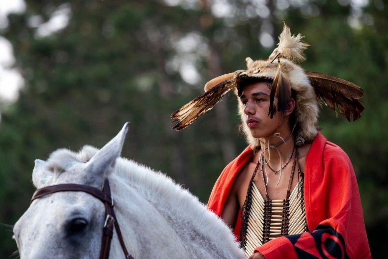 An Anishinaabe tribal community member greets people