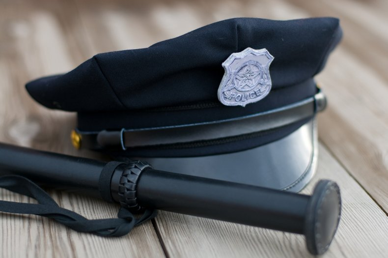 Police hat and truncheon