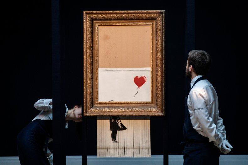 """Banksy's """"Love is in the Bin"""" piece."""