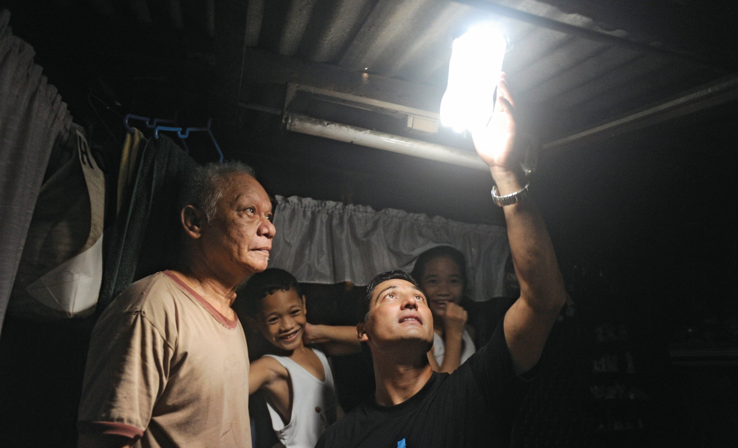 How A Water Bottle Can Bring Light To Dark Shacks