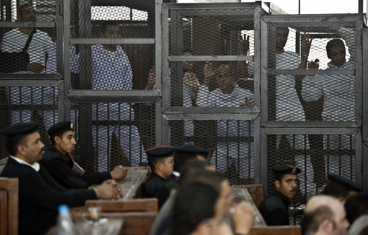 Journalists on Trial and in a Cage in Egypt