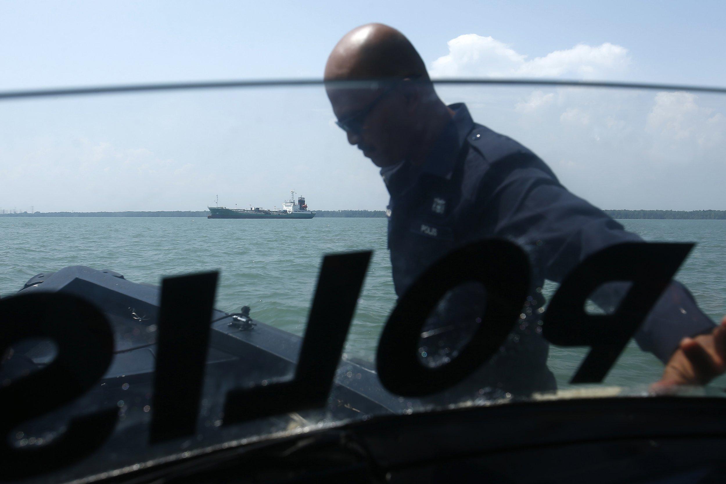 Pirates raid oil tanker off malaysia take away three crew for Bureau raid crew