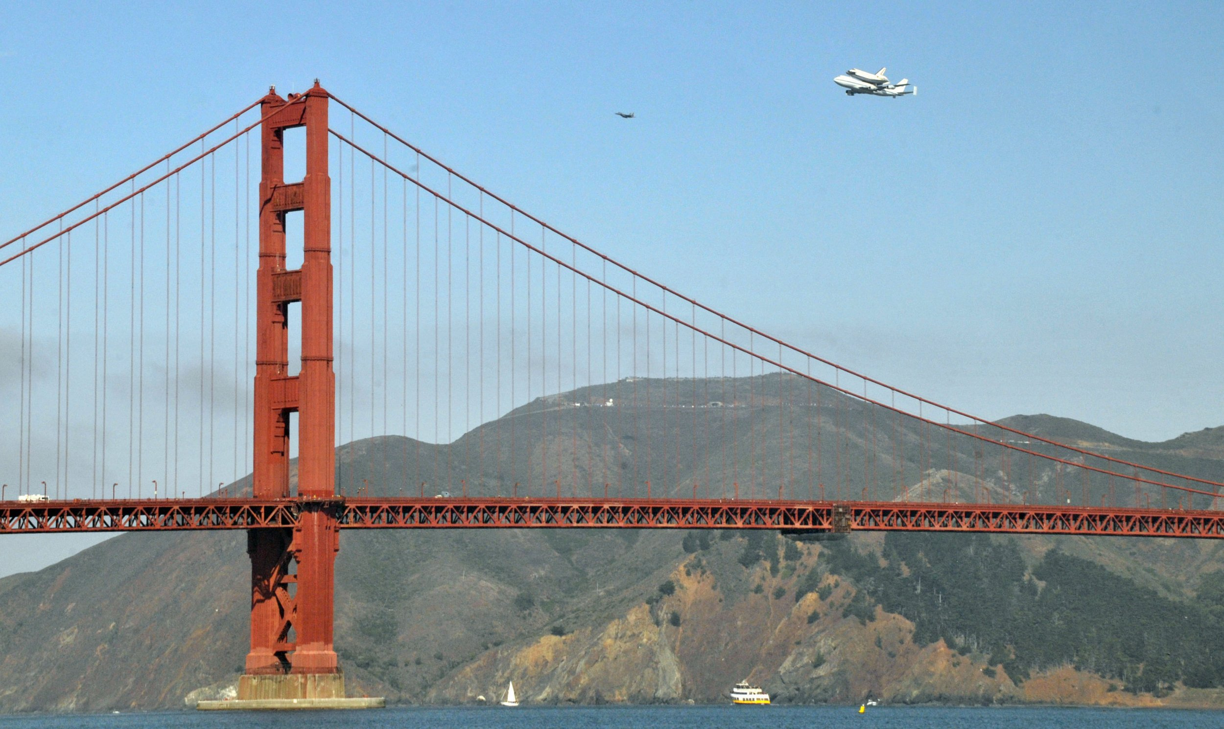 The space shuttle Endeavour flies past the Golden Gate Bridge in San Francisco on the back of a 747 en route to Los Angeles International Airport September 21, 2012.