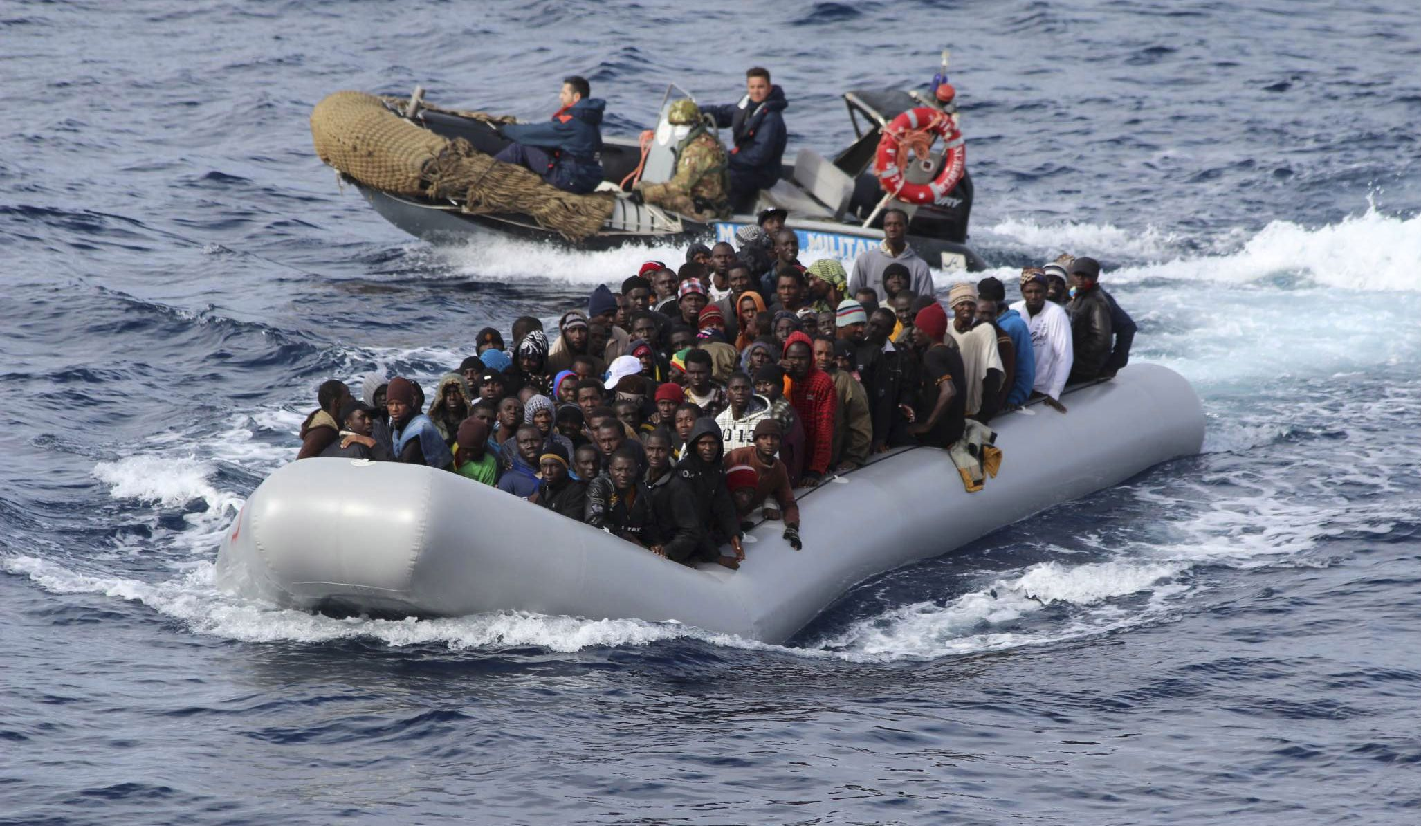 Migrants in a boat off Sicily