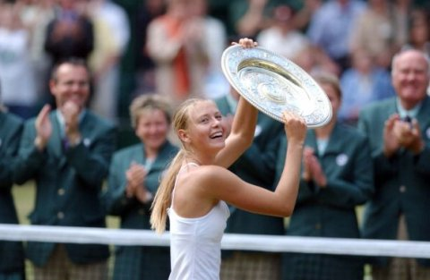 Maria Sharapova holding the Wimbledon trophy after beating Serena Williams in 2004, aged 17