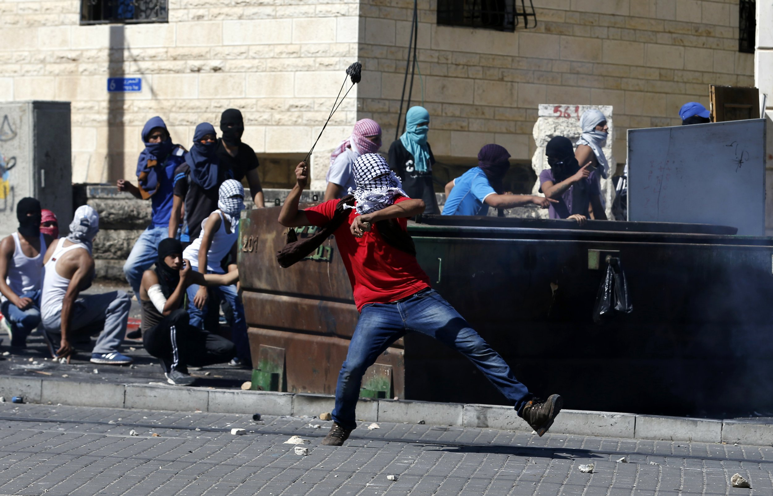 Palestinian hurling stone in Jerusalem