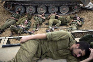 Israeli soldiers sleep near the Gaza Strip