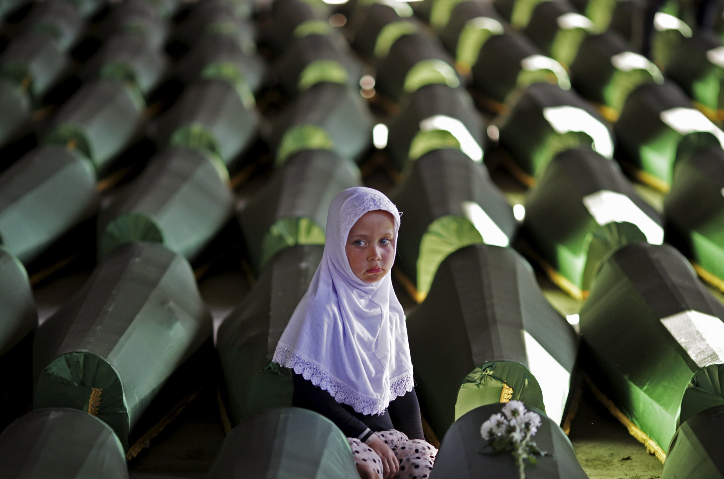Girl sits on Srebrenica coffin