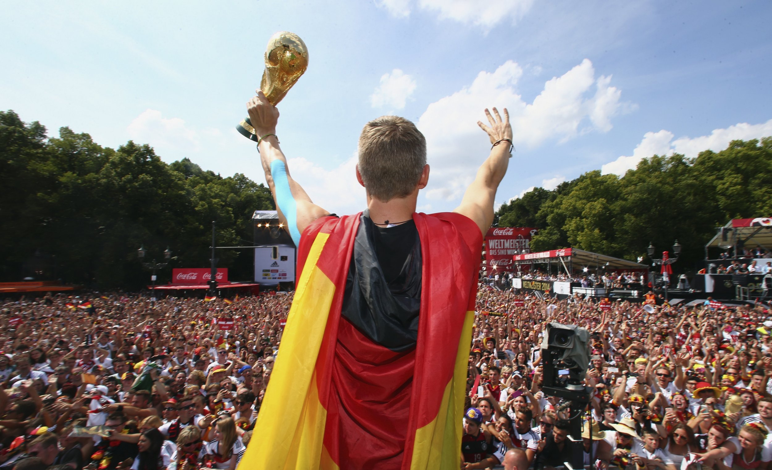 Bastian Schweinsteiger holding the World Cup