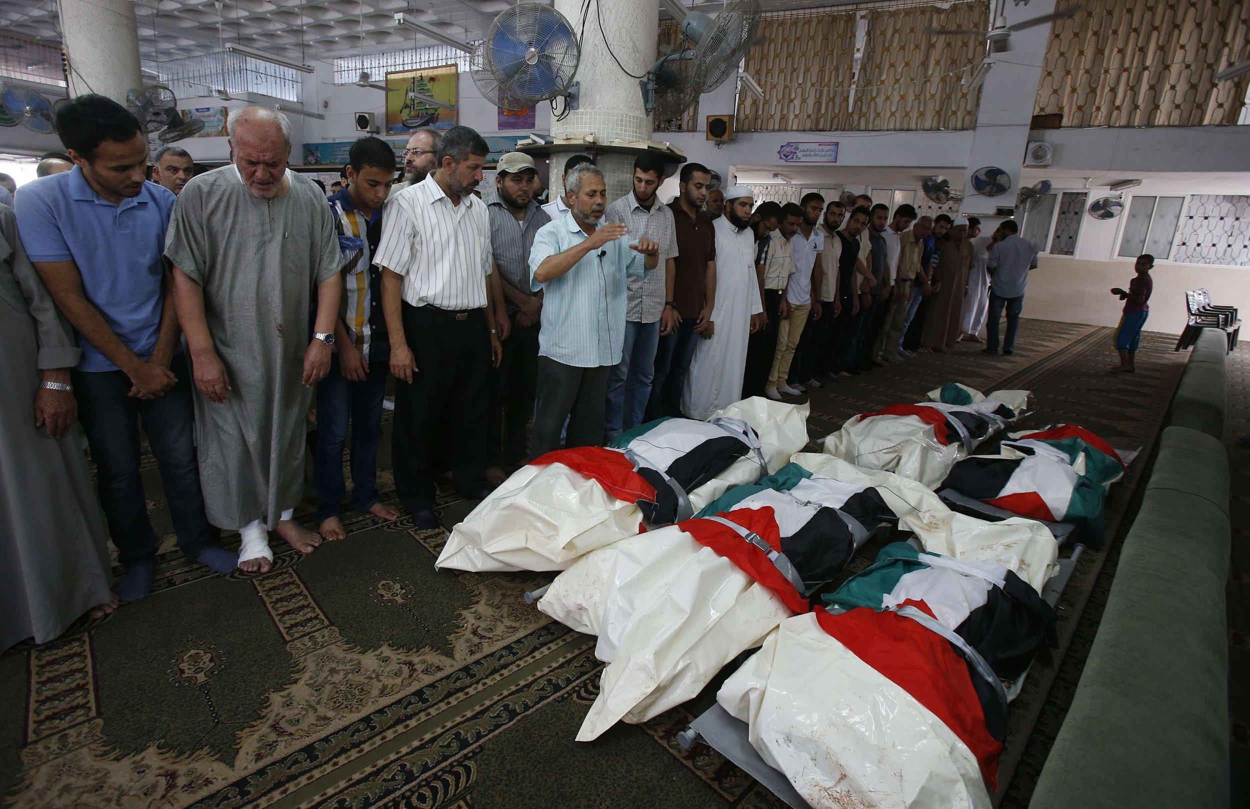 Palestinians pray at funeral