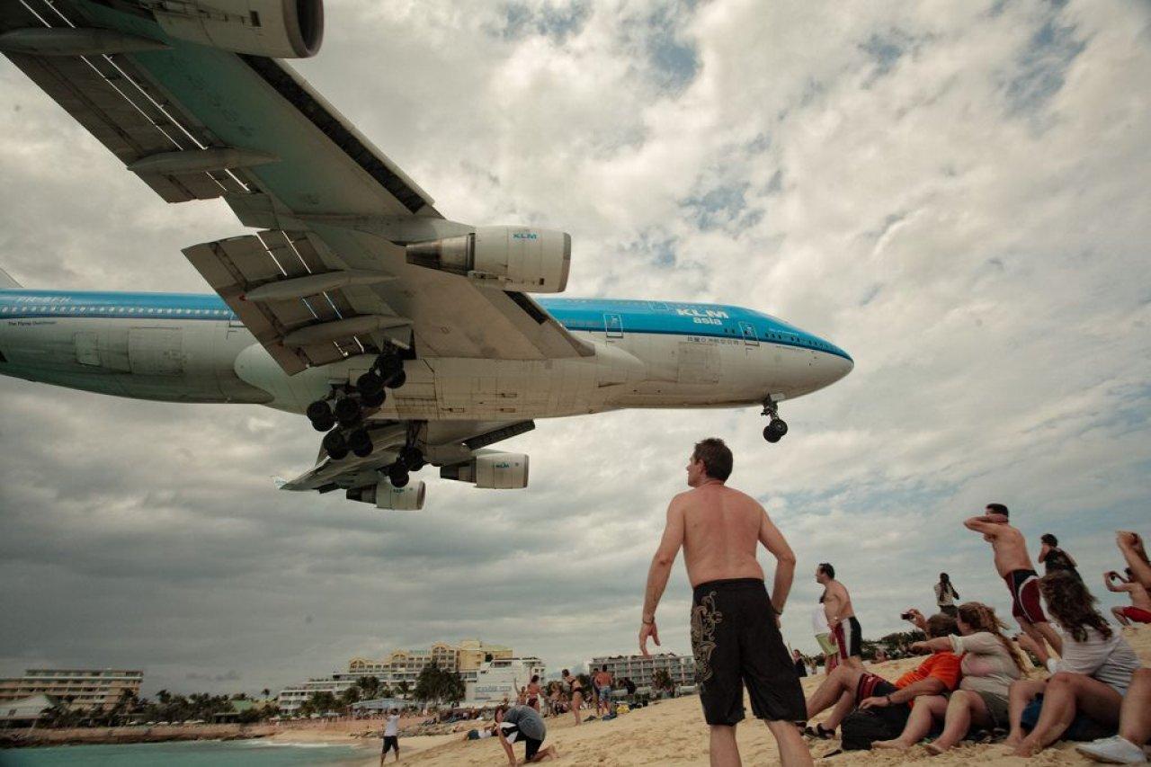 Plane landing over Sint Maarten beach