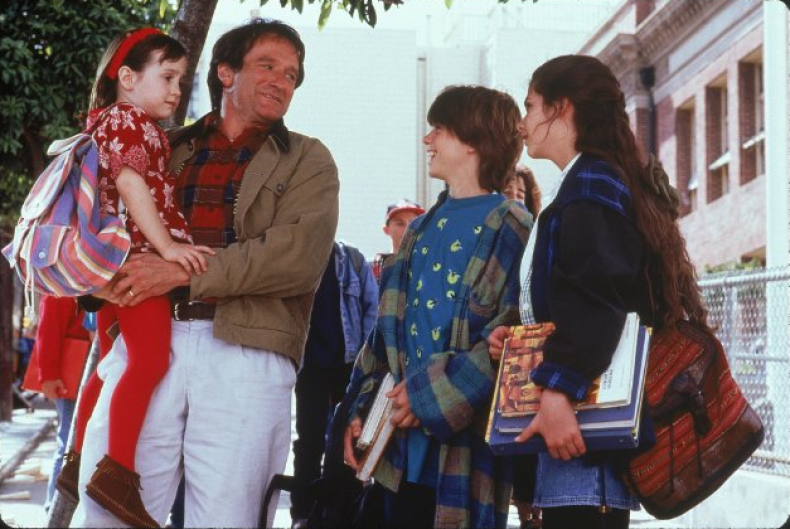 Lisa Jakub (right) with Robin Williams and her fictional siblings.