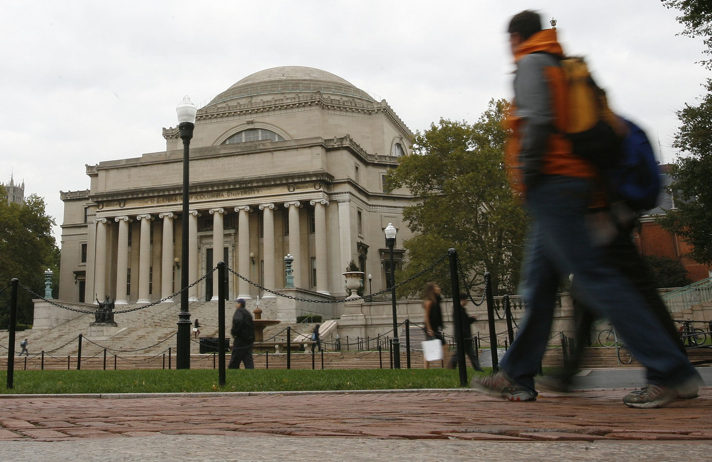 Students walk across the campus of Columbia University in New York in this picture taken October 2, 2009.